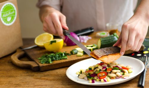 man cutting salmon to do hellofresh review