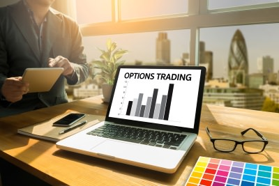 options trading with laptop